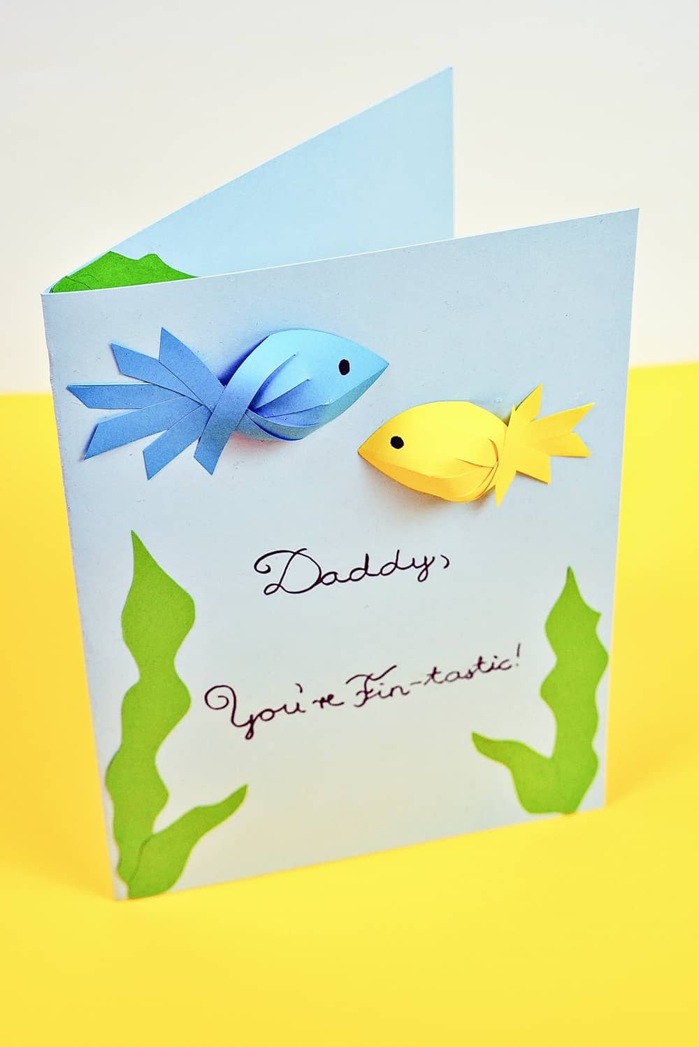 Father's Day Fish Card kids can make with showing blue and yellow paper fish. Free printable template included.