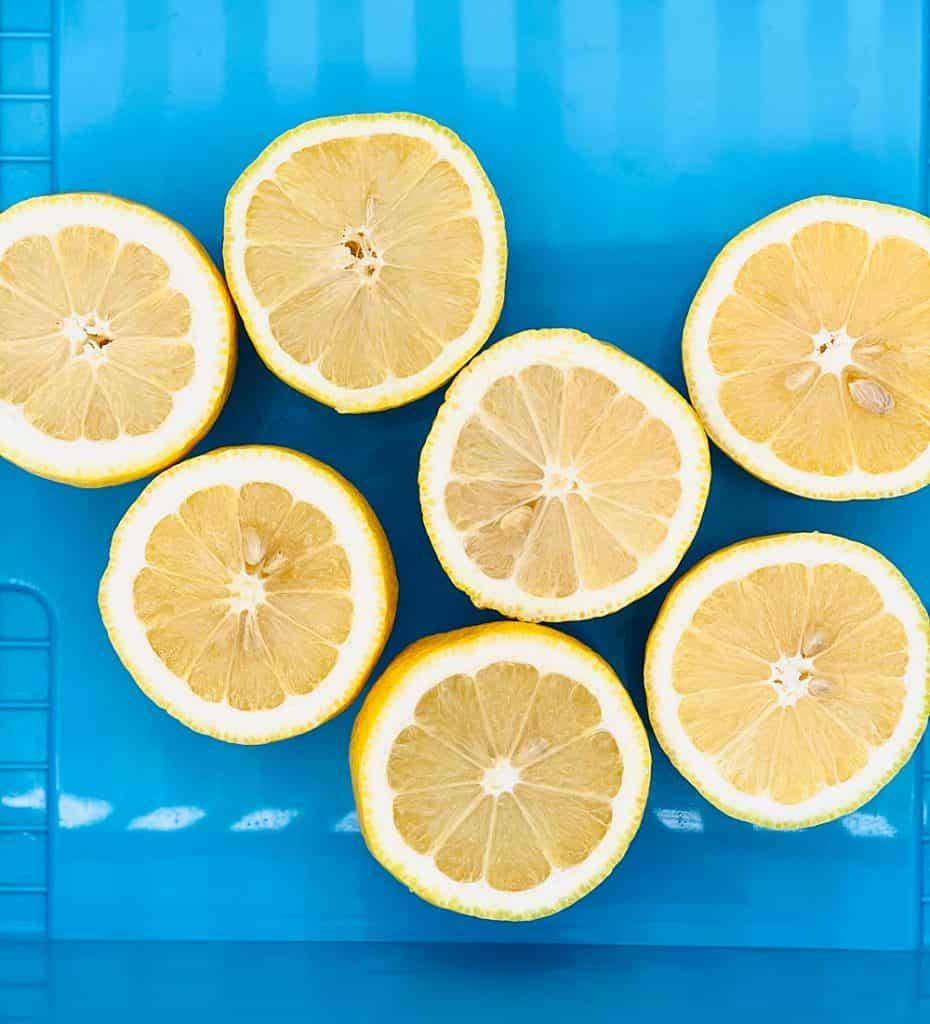 cut halved lemons inside a blue bin