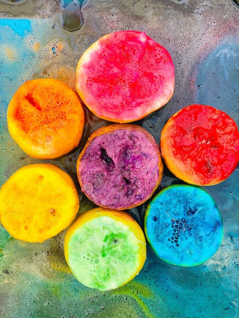 lemon volcano eruptions in rainbow colors from kid science experiment