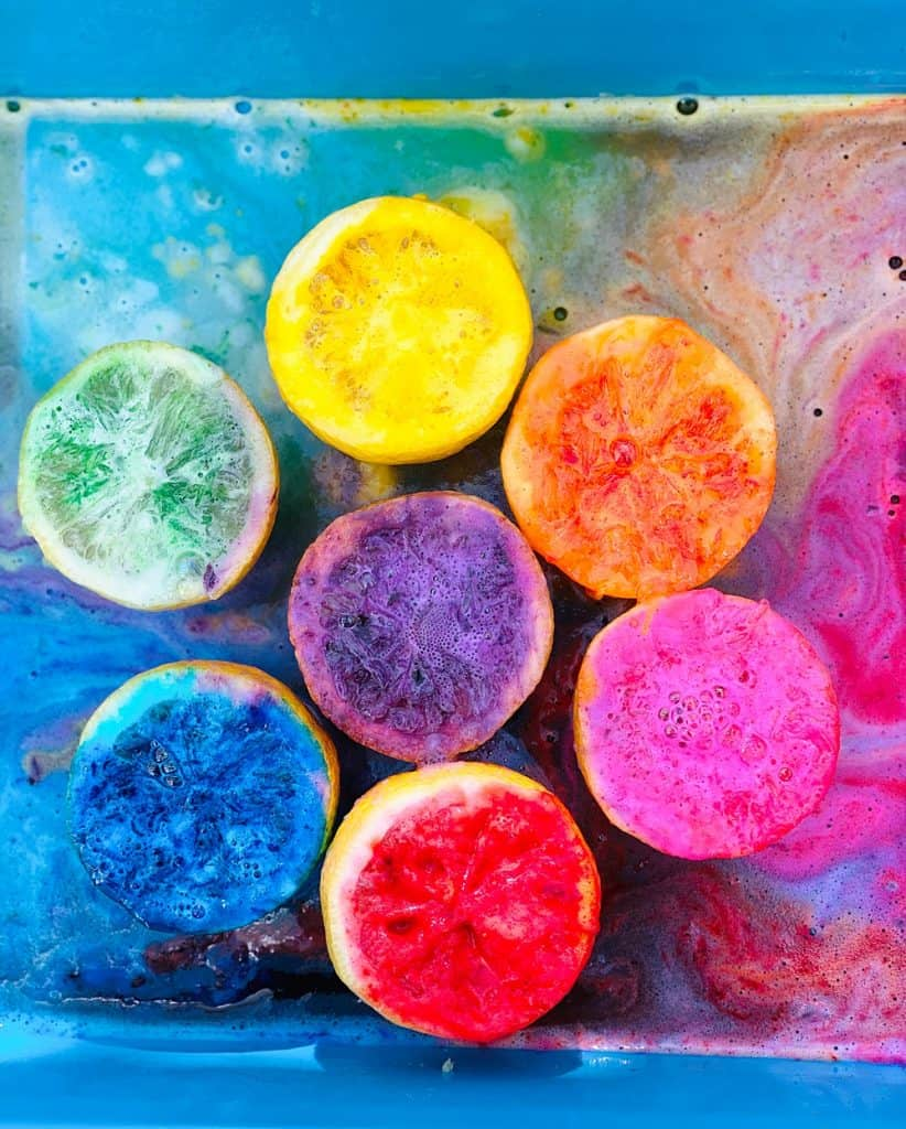 fizzy rainbow colored lemon halves from making volcanoes