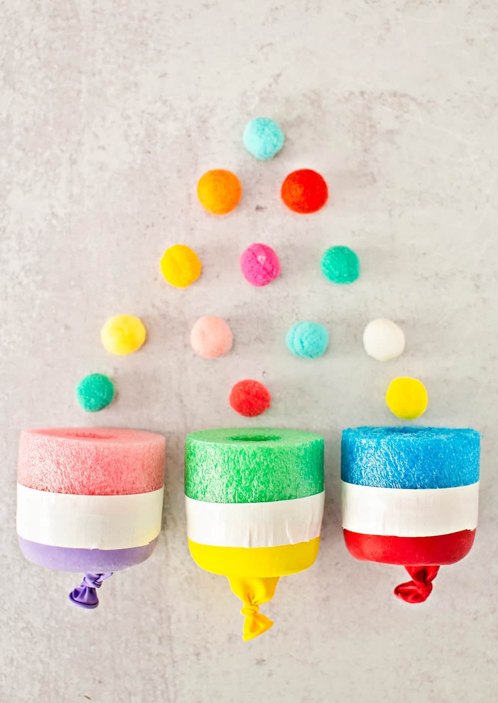 3 pom pom noodle shooters with pom poms coming out