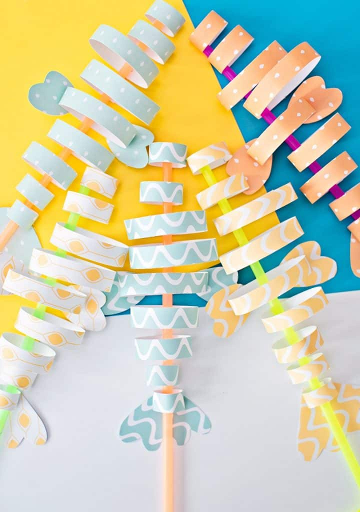 paper fish craft made from colorful strips of paper and straws