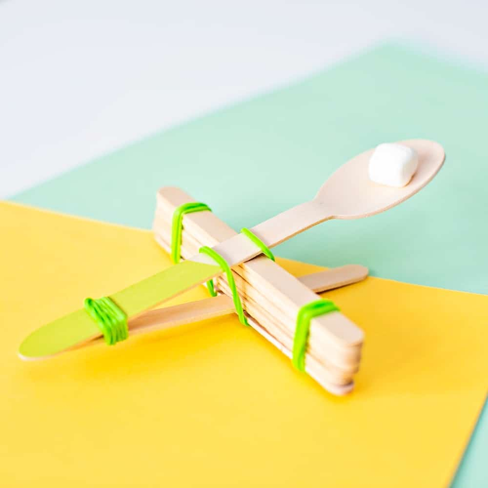diy marshmallow catapult with spoon and popsicle sticks