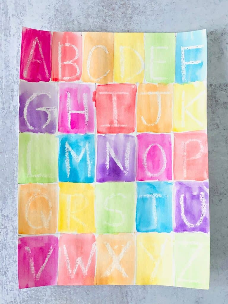 Letter learning activity for kids using crayon resist and writing out the alphabet