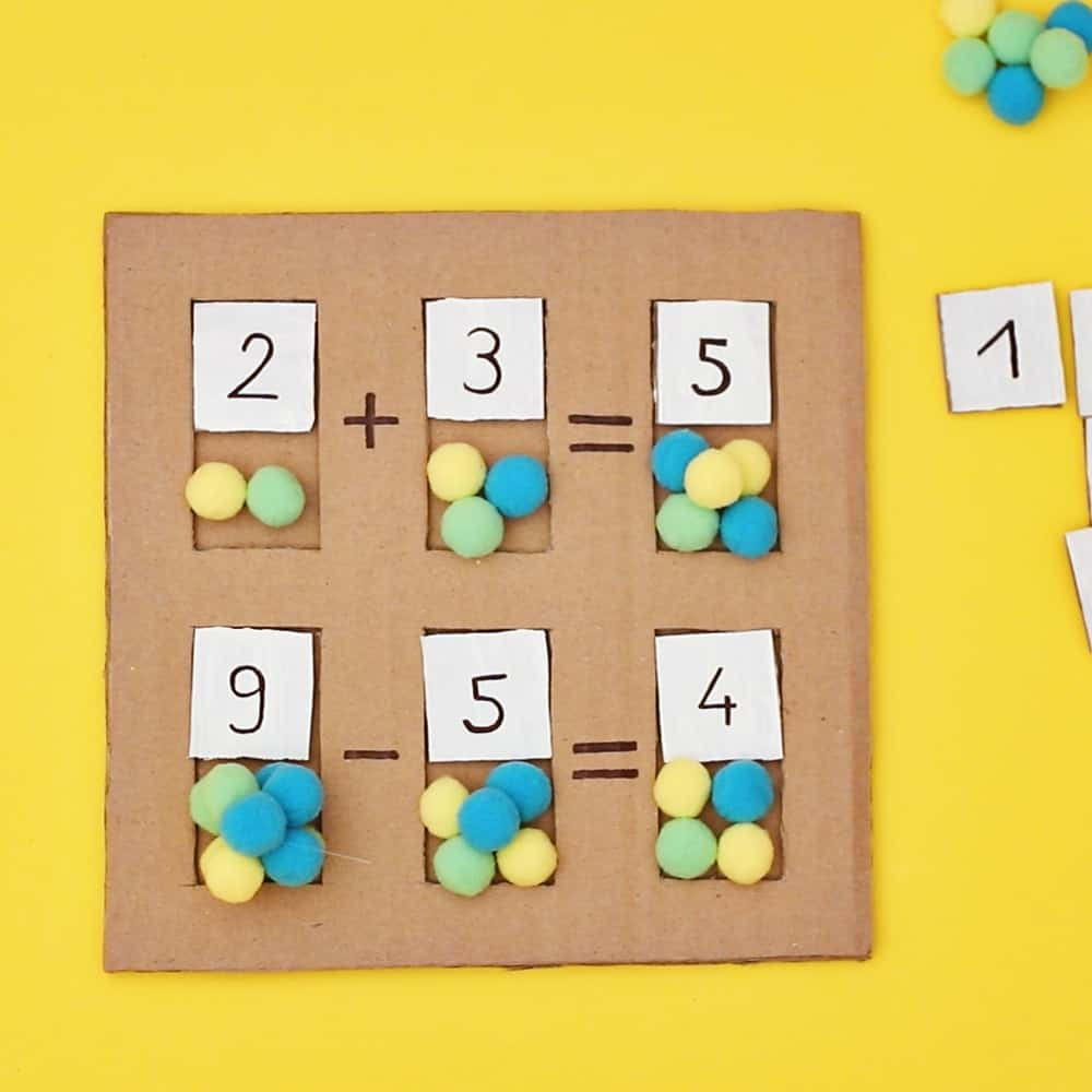 early math learning cardboard board with pom poms as counters