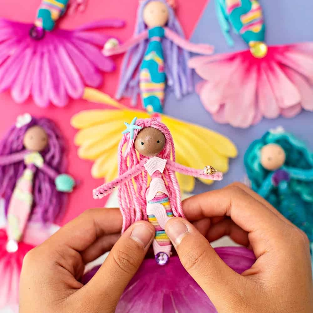 diy mermaid dolls made with pipe cleaners, flowers, yarns and ribbon