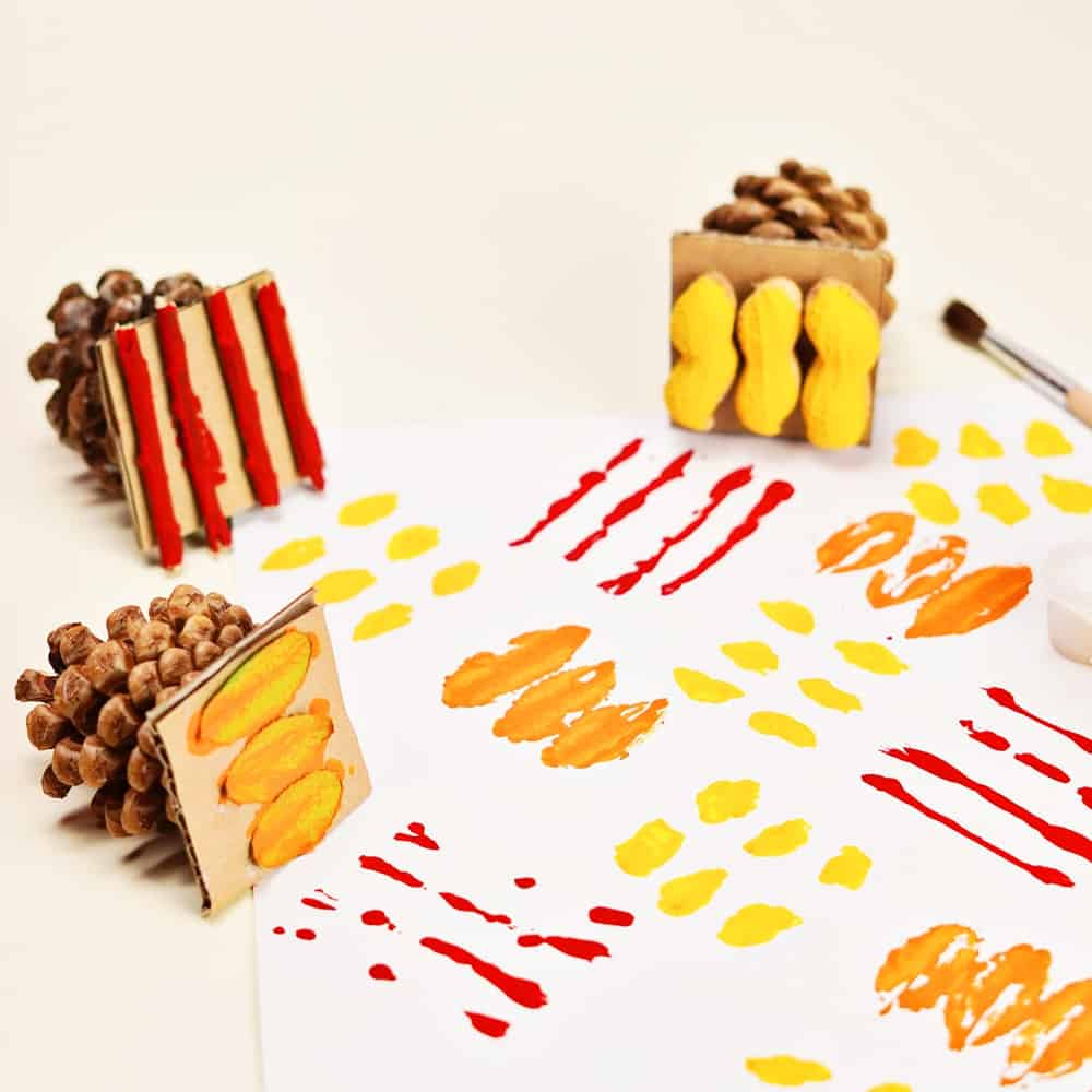 fall art stamps using pine cones and fall foliage